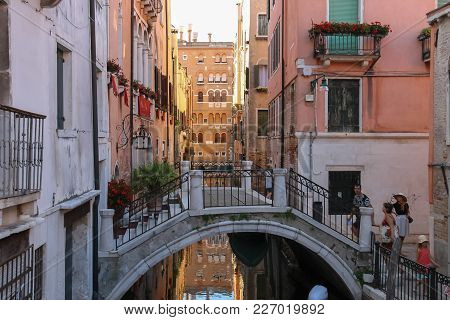 Venice, Italy - August 13, 2016: Tourists On Small Bridge Of Historic Center In Venice, San Marco