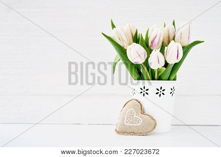 White Tulips Bouquet In White Vase Decorated With Textile Heart. Valentines Day Concept. Copy Space