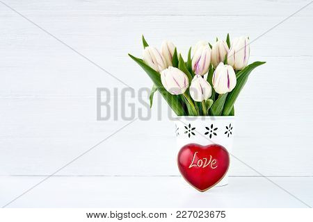 White Tulips Bouquet In White Vase Decorated With Red Heart. Valentines Day Concept. Copy Space