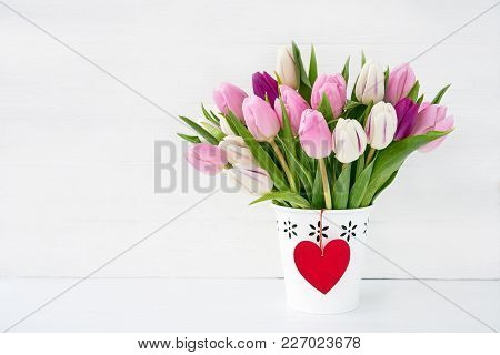 Pink And White Tulips Bouquet In White Vase Decorated With Red Heart. Valentines Day Concept. Copy S
