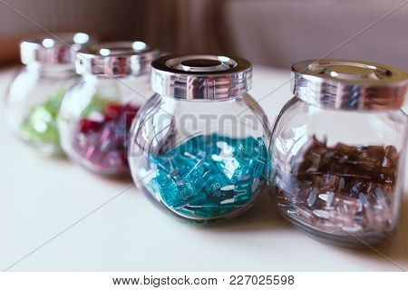 Car Electric Parts Colorful Mini Fuses In Kitchen Spice Rack On Desk. Soft Focus.