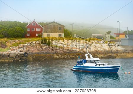Boat Near Coast With Homes In Norway, Scandinavia, Europe.