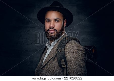 Handsome Black Bearded Male Dressed In A Suit From A Wool And Cylinder Hat.