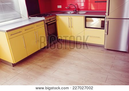 Yellow Kitchen With Cupboards With Hinged Doors, Topped With A Grey Worktops And Fitted With Applian