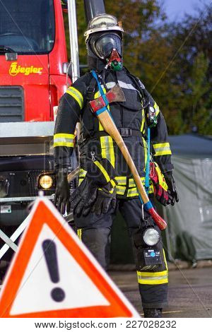 Munster / Germany - October 9, 2017: German Fireman Puppet Stands Near A Fire Engine On A Presentati