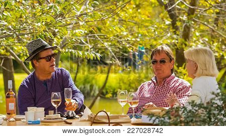 Johannesburg, South Africa, 05/10/2014,  Middle Aged Couples Enjoying Wine With Friends At The Winte