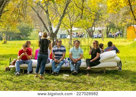 Johannesburg, South Africa, 05/10/2014, Friends Sharing A Moment Under The Trees At The Winter Sculp