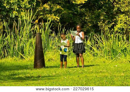 Johannesburg, South Africa, 05/09/2015, Two Young African Girls Looking At Art At The Winter Sculptu