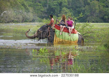 Sigiria, Sri Lanka - March 16, 2015: The Elephant Sprinkles Water. Elephant Safari On A Tropical Lak