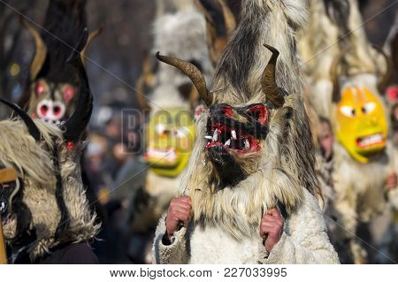 Participants Take Part In The International Festival Of Masquerade Games Surva. The Festival Promote