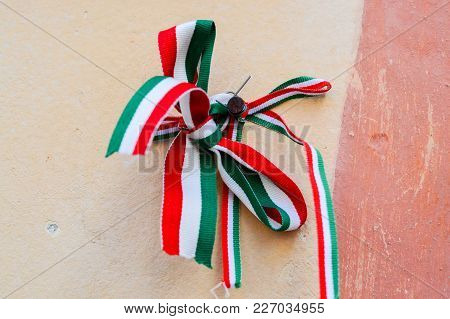 Ribbon With National Colours Of Hungary Tied Up To The Castle Wall In Mukachevo, Ukraine. National M