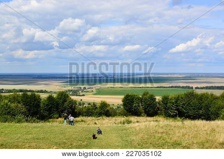 Pidhirtsi, Ukraine - August 24 , 2017 , Tourists Are Sitting On The Meadow With Great Panoramic View
