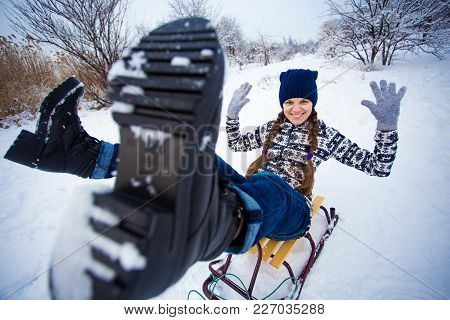 Crazy Woman Enjoy A Sleigh Ride. Woman Sledding. Funny Woman Play Outdoors In Snow. Woman Sled In Al