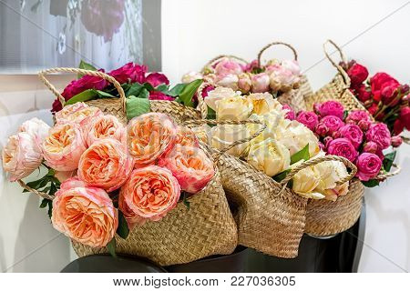 Roses Peony Modern Elite Varieties In A Bouquet In Wicker Baskets As A Gift. Close Up. Selective Foc