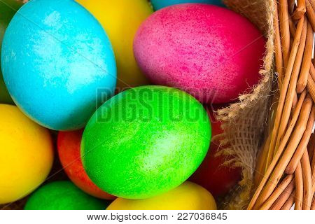 Brightly Colored Closeup Easter Eggs In Basket, Holiday Background