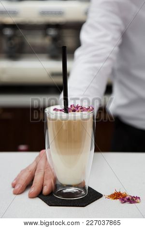 Men Barista Submits Glass Of Latte Serving A Client. Vertically Framed Shot.