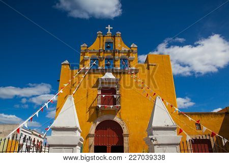 Yellow Colonial Church With A Deep Blue Sky In Campeche, Mexico.  The City Is Known For Its Beautifu