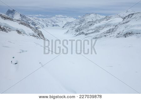 View from the jungfrau mountain summit towards the Aletsch glacier. Bernese Oberland, Switzerland. Swiss Alps poster