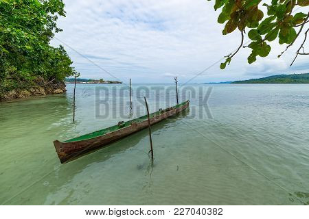 Tropical Beach, Caribbean Sea, Canoe Floating On Transparent Turquoise Water, Remote Togean Islands
