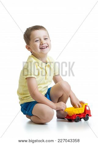 Child Boy With Toy Isolated On A White Background