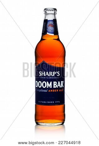 London, Uk - February 14, 2018: Cold Bottle Of Sharp's Doom Bar Amber Ale On White.