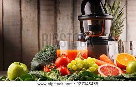 Slow Juicer With Organic Fruits And Vegetables.