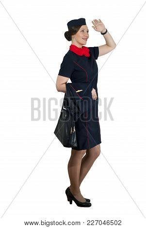Stewardess On White Background Smiling Looking Into The Distance