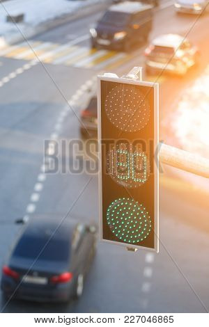 Green Color Light Is Shown On A Modern Led Traffic Light Hanging Over The Road