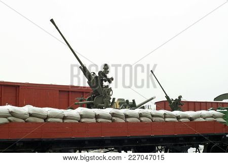 Old Anti Aircraft Guns On Railway Platforms