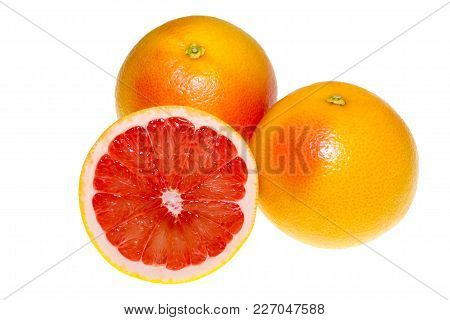 A Pair Of Bright Orange Grapefruits Isolated On A White Background. A Whole And A Cut In Half Grapef