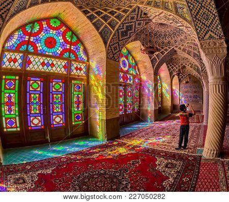 Shiraz, Iran - May 2, 2015: The Boy Photographing Praying Room Of The Beautiful Interior Of The Nasi