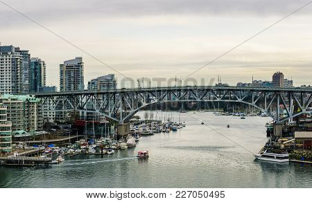 Vancouver, Canada - February 9, 2018: View From Burrard Bridge To Granville Island And Vancouver Dow
