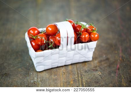 Cocktail Tomatoes In A Basket, Wood Background