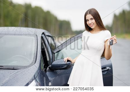 Happy Woman Driver Showing Car Keys Outdoor