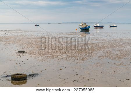 Boats At Low Tide On The Shore Of The River Thames, Seen In Southend-on-sea, Essex, England, Uk