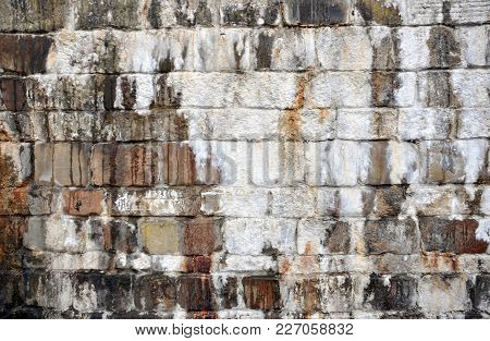 Old Streaked Stone Wall With Damp Stains And White Encrusted Surface