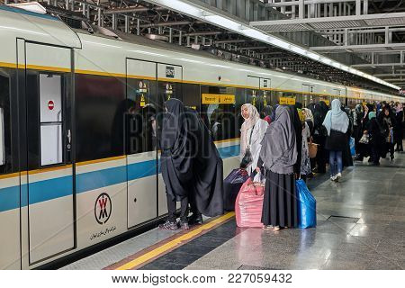 Tehran, Iran - April 29, 2017: Several Muslim Women Are Waiting For The Opening Of The Doors Of The