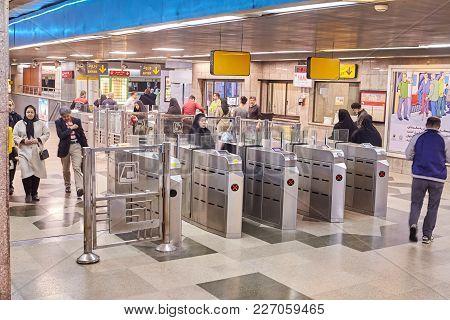 Tehran, Iran - April 29, 2017: The Station Of The Tehran Subway, People Pass Through Turnstiles Inst