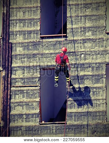 Fireman Rappelling The Wall During The Fire Drill With Vintage Effect