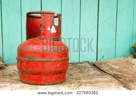 Red Old Gas Cylinder In The Summer Farm