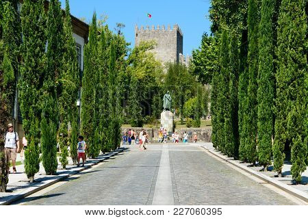 Guimaraes, Portugal - August 15, 2014 : Tourists Visiting The City Near The Statue Of Afonso Henriqu
