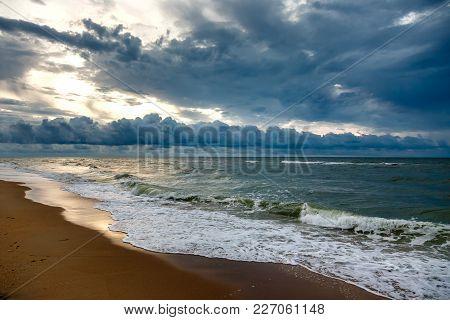 Dramatic Sky On A Morning Seascape. Storm On A Sandy Sea Beach.