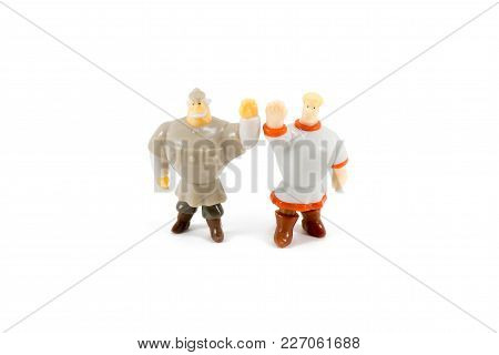 Russia Two Heroes Toys On White Background