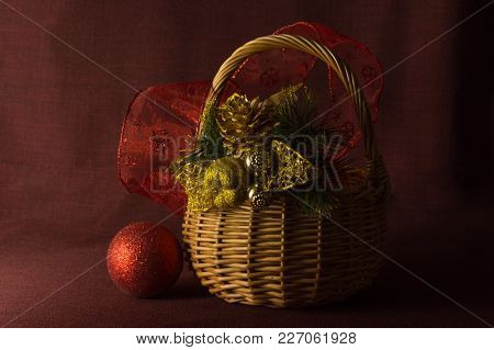 Vintage Christmas Composition With Wooden Basket With Toys And Gifts