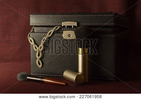 Vintage Black Leather Case With Jewelry On Dark Background