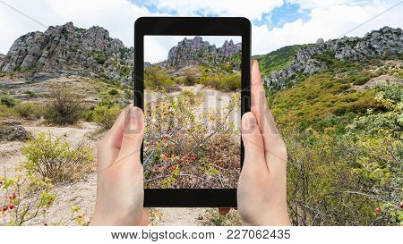 Travel Concept - Tourist Photographs Demerdzhi Mountains From The Valley Of Ghosts On Crimean Southe