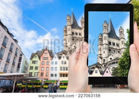 Travel Concept - Tourist Photographs Fischmarkt Square And Great St Martin Church In Cologne City In