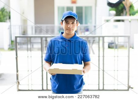 Happy Delivery Person In Blue Uniform Holding Pizza Box Standing In Front The Home Customers,deliver
