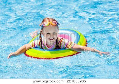 Child In Swimming Pool. Kids Swim. Water Play.