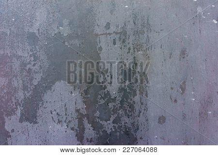 Old, Rusty Metal Surface. Grunge Dark Background. Close-up Photo